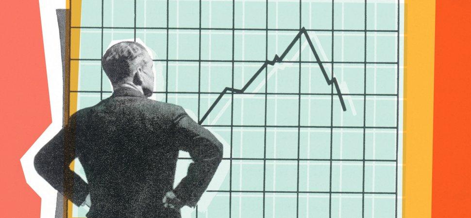 man looking at stocks