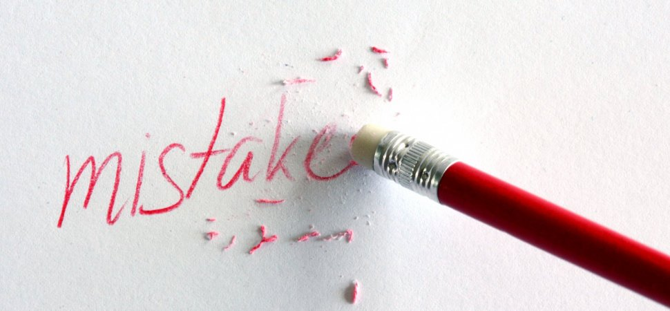 pencil erasing the word mistake