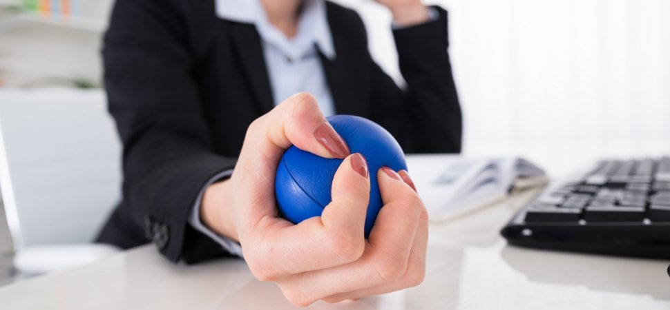 business woman squeezing stress ball